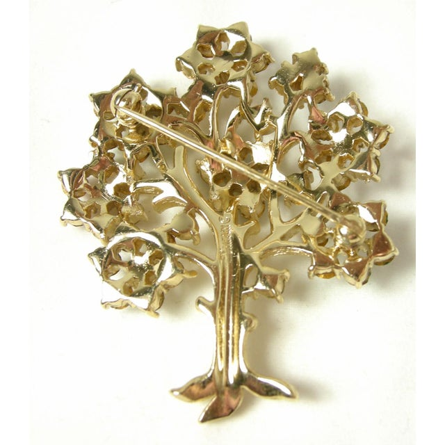 """This is the famous Trifari """"Tree of Life"""" brooch with red, green, blue and clear crystals in a gold tone setting. In..."""