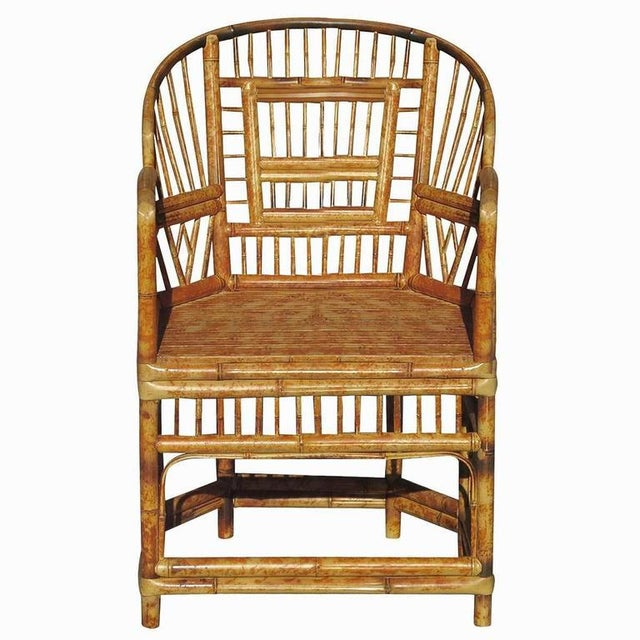"""""""Brighton"""" tiger bamboo armchair features a unique crisscross backing and beautiful tiger poll rattan construction...."""