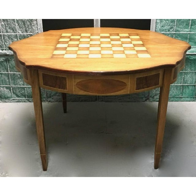 Beautiful mahogany demilune table works against any wall but also has the versatility of a game table. The top flips open...