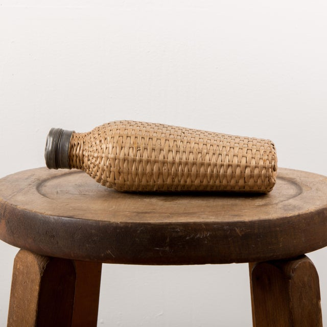 1920 European wicker woven covered glass bottle. I bought this flask at a flea market in Denmark , it was the hottest...