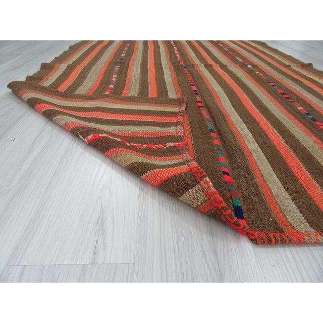 Vintage Brown and Orange Striped Decorative Turkish Kilim Rug - 4′9″ × 7′3″ - Image 6 of 6