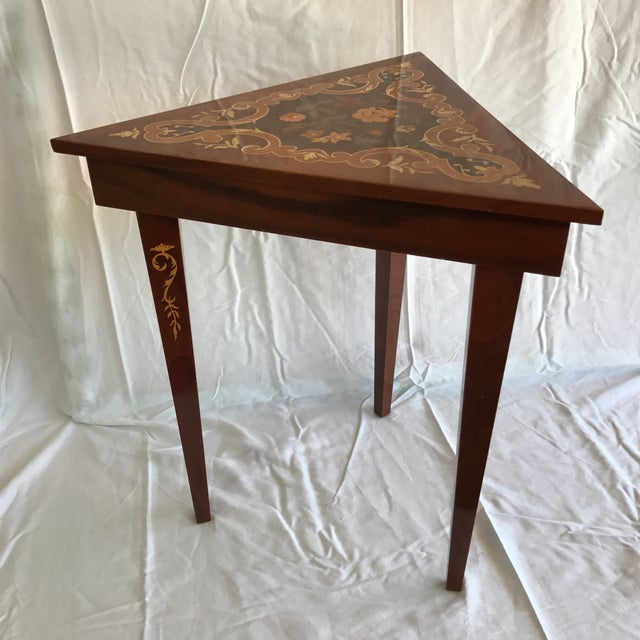 Beautiful inlaid Italian music box table. Excellent condition, nice and lightweight.