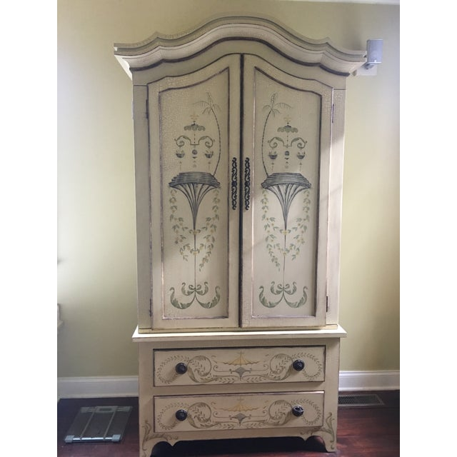 hand painted, solid wood, interior 4 shelves and 2 pull out drawers, perfect condition with fine hardware