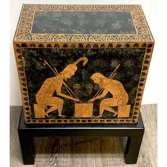 Grand Tour style polychromed Greek motif cabinet on stand, with beautiful decoration on all sides. In two parts. Fitted...