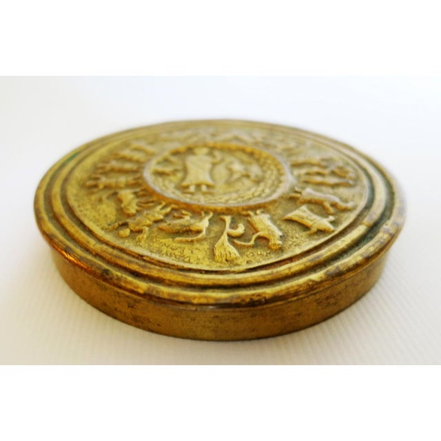 """A gilt bronze box or podier by French Jeweler Line Vautrin, in the pattern of """"Moise ou la traversee du desert"""" coric..."""