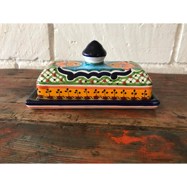 Hand painted colorful butter dish with lid. Made in Mexico, Talavera pottery. In new condition with original tag attached.