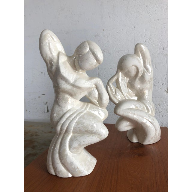 A pair of large vintage Post-Modern Art Deco Inspired Plaster Figurines with glaze decoration, from the 1980s. Feature...