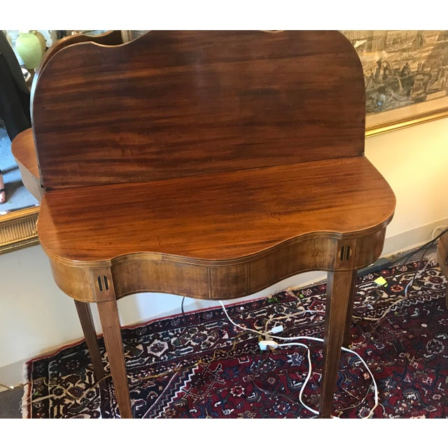 """Mahogany """"bridge"""" table with drop down/flip top. Inlay detail at top of legs. This table is a gorgeous addition to your..."""