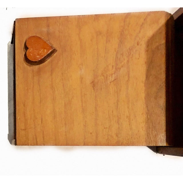 A charming, hand made, hinged marquetry box. Box opens and reveals a carved heard that interlocks with with a heart shaped...
