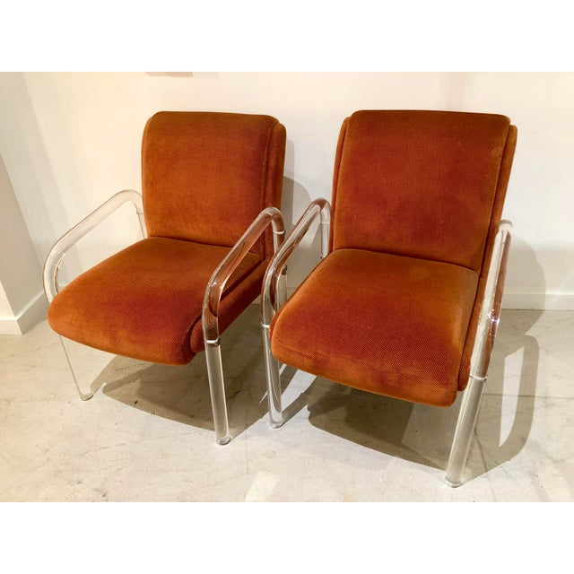 Pair of acrylic retro armchairs by Lion in Frost. We are selling these in pairs however we have six total available.