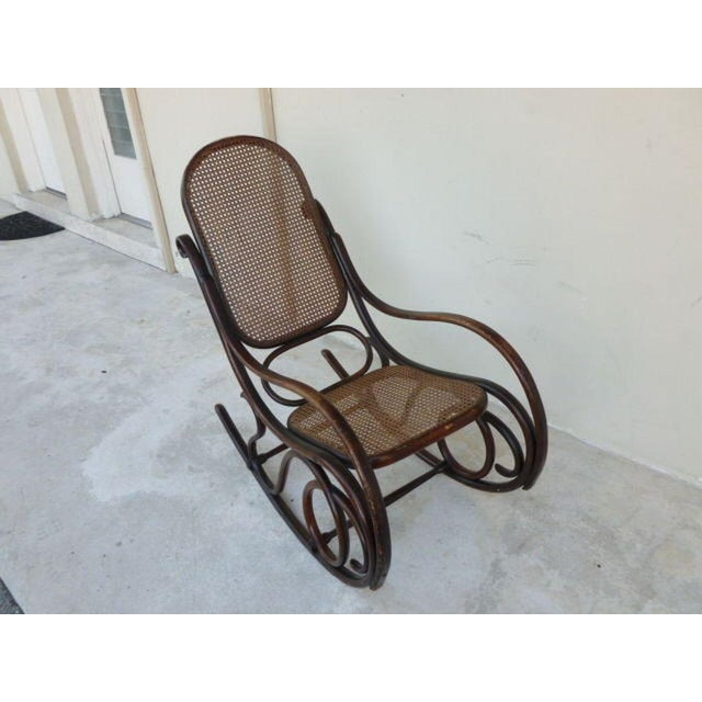 Authentic original condition signed Thonet bentwood rocker desirable form circa 1896. Chair is 40 inches high x 40 inches...