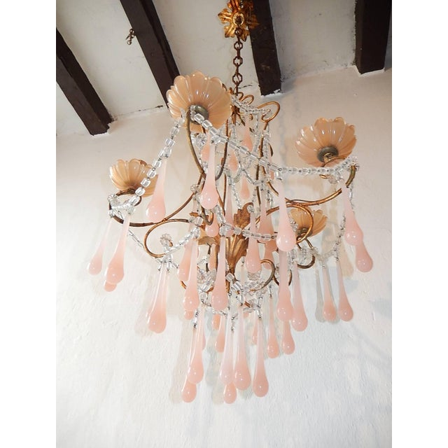 Housing five lights sitting in pink opaline bobeches. Re-wired and ready to hang. Metal body with swags of macaroni beads....