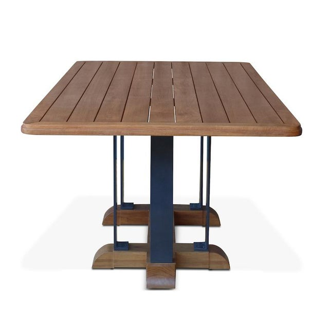 The indoor/outdoor Montecito Dining Table comfortably seats eight people around it. Teak planks, a powder coated aluminum...