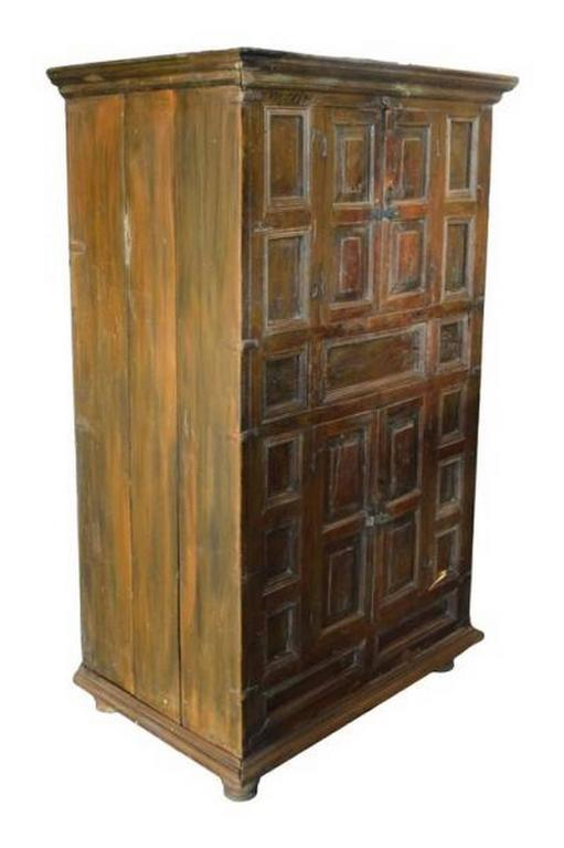 A Mid 19th Century Rustic Wooden Cabinet With Five Hand Carved Doors Made  In India
