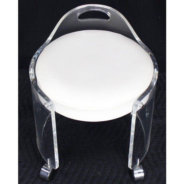 Mid-Century Modern round upholstered bent Lucite stool on wheels. Thick Lucite solid and steady design.