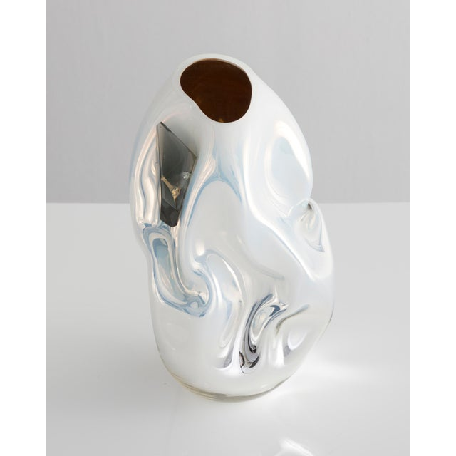 Unique petite crumpled sculptural vessel in silver and white mirrorized hand-blown glass with applied glass crystal....