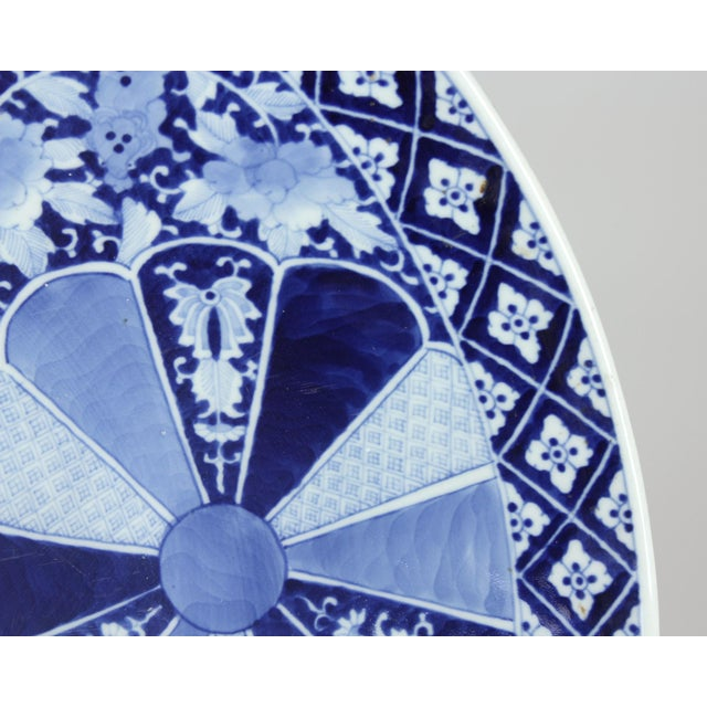 A very unusual large Japanese Imari charger dating to about 1870 and measuring 24″ in diameter. Decorated in classic...