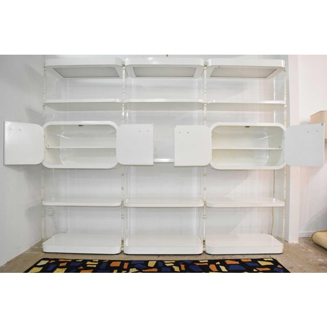 Beautiful 1970s white lacquer bookcases with thick Lucite supports. We have had the Lucite polished so no scratches....