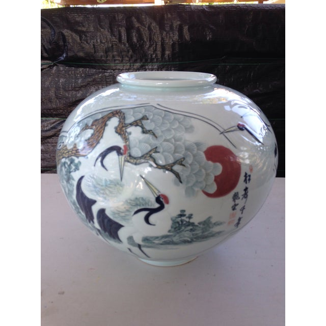 "Elegant large Asian vase with scenery of an old tree and a few cranes. 20"" diameter 16"" tall."