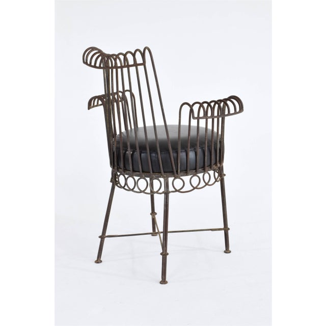20th century vintage armchair, or side chair by the iconic French pioneer designer Mathieu Matégot. We have deliberately...