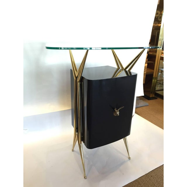 Italian modernist dry bar with floating glass top and brass accents. 2 available.