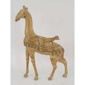 American carousel style (20th Cent) stripped pine large giraffe figure with gold trim and wearing a saddle