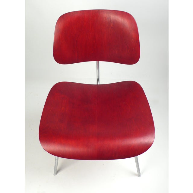 Early Production red analine dye DCM designed by Charles Eames manufactured by Herman Miller. Chair is in very good...