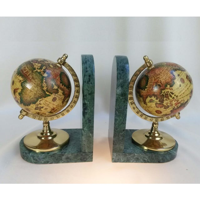 Beautiful Old World Globe Bookends on Solid Green Marble Handsome pair of revolving old world globe bookends Features a...