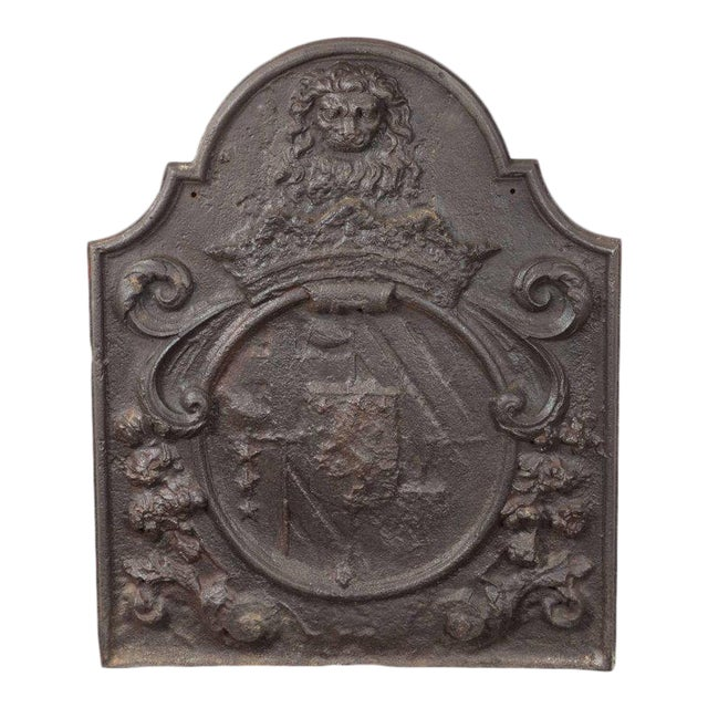 Dutch Armorial Fireback with Lion's Head Motif and Crest on Arch Top Panel For Sale
