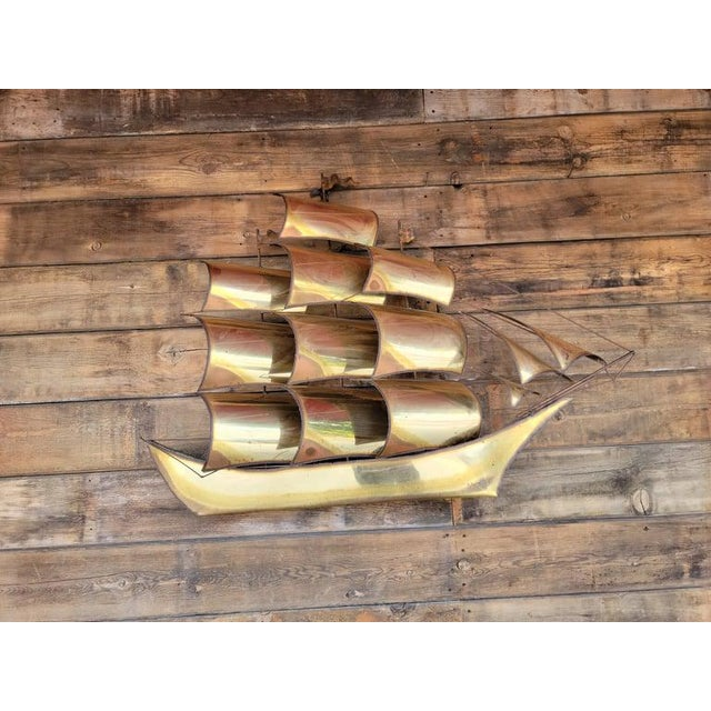 Vintage brass clipper ship wall hanging décor/sculpture. Showing mark of used and aged. Signed by artist.
