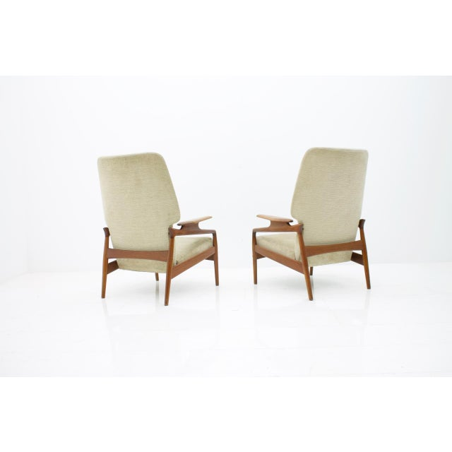 Pair of Lounge Chairs by John Boné Denmark 1960s. The Backrest is Adjustable in four Positions. The Armchairs are very...