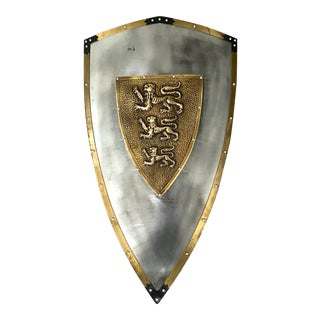 Metal Shield With Center Brass Lion's Crest For Sale