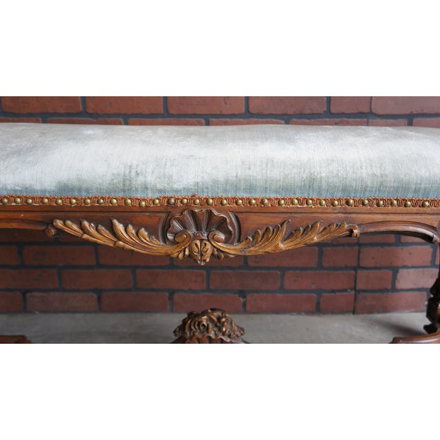 Antique French bench which will be the perfect conversation piece in any room. Its sweet intricately carved details give...