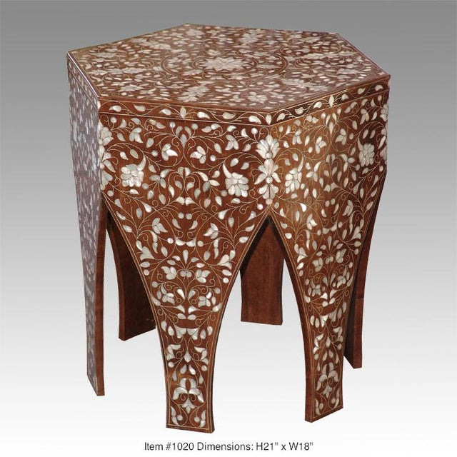 Lofty Syrian side table crafted with exotic walnut-wood. The hexagon top features interlocking flourish designs in mother-...