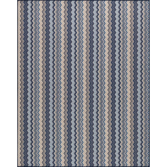 """Made of 100% wool. Pattern repeat is 3.5""""L x 1'4""""W."""