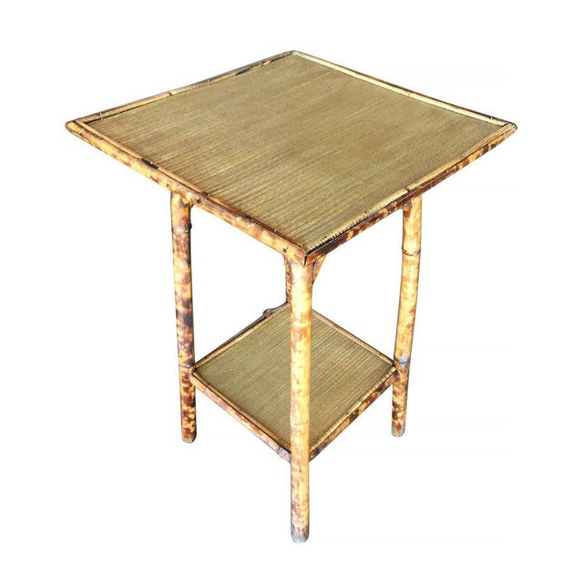 Antique tiger bamboo pedastal side table with slat bamboo top and secondary bottom shelf. Refinished to new for you. All...