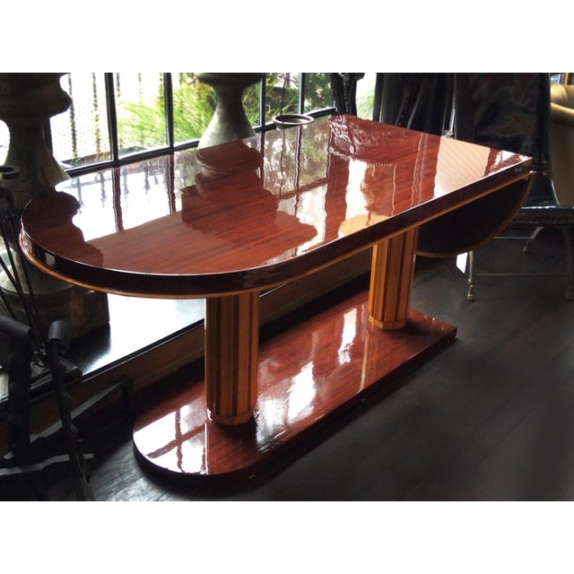 A superb drop-leaf desk by the American designer Gilbert Rohde. Circa 1930s-1940s. The desk is crafted from mahogany and...