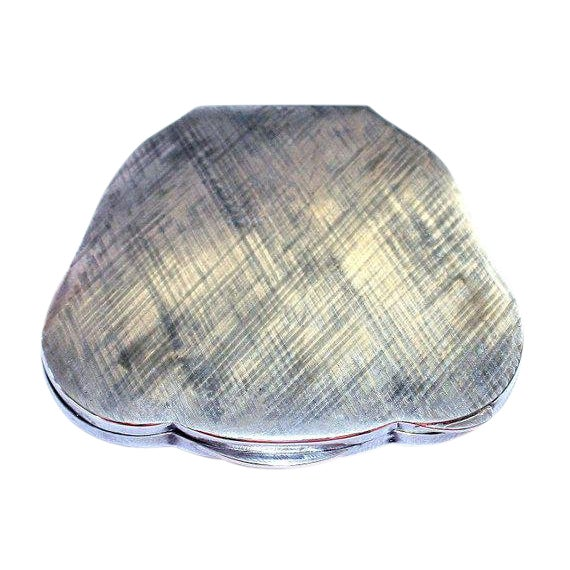 Wonderful c.1940's Italian 800 silver powder compact with a brushed matte finish and a round cartouche surrounded by an...