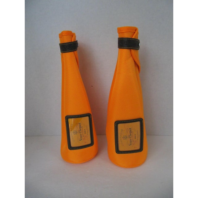 Every picnic and party needs champagne. Keep your cool with a pair of iconic orange Veuve Clicquot Ice jackets. The...