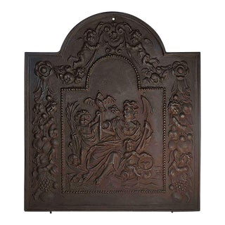 Late 19th Century Cast Iron Black Fireback With Classic Imagery For Sale