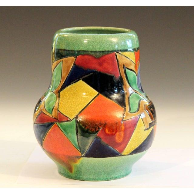 Vintage Awaji vase with interesting fragmented Art Deco design of a potted plant against a light green crackle glaze...