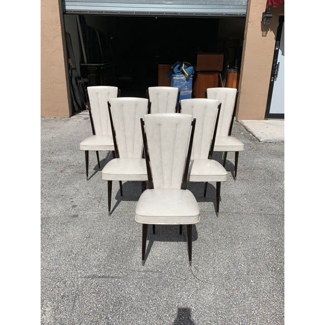 Classic set of six French Art Deco dining chairs solid mahogany circa 1940s , the two front feet are capped with brass....