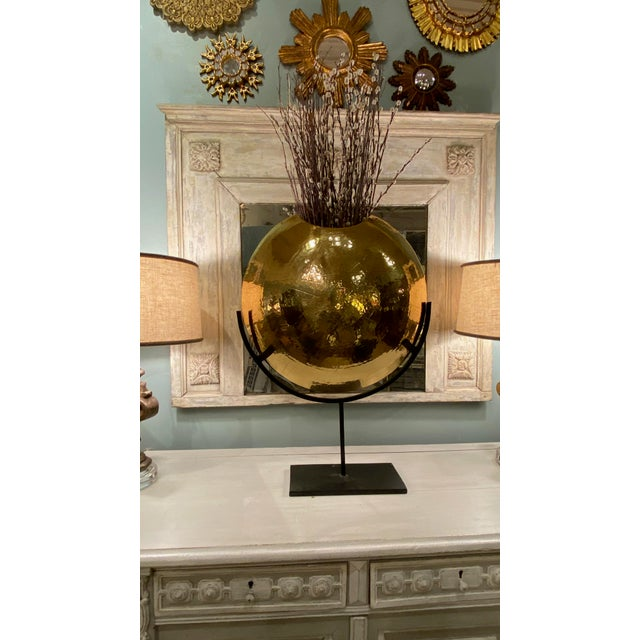A wonderful contemporary style circular brass and iron vase. A large and commanding piece that really makes a presence.