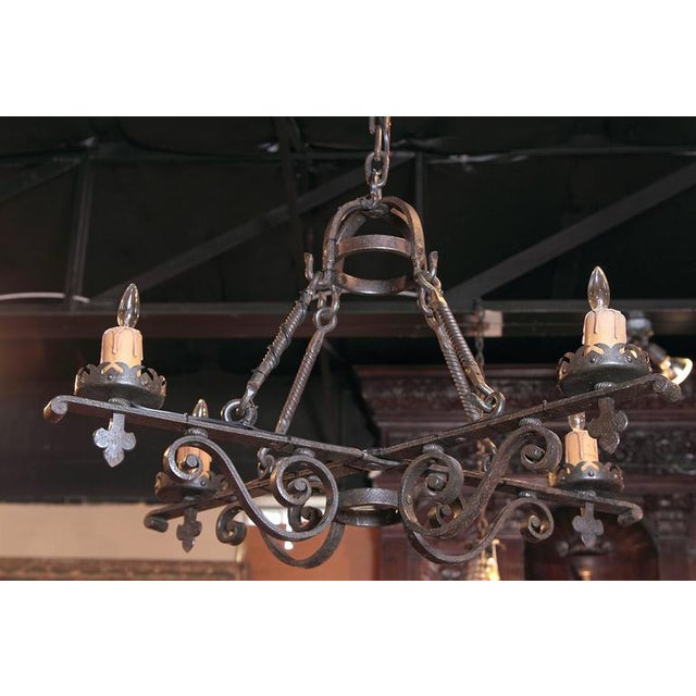 For a rustic, Gothic home, look no further than this heavy iron chandelier. Forged in France, circa 1880, the chandelier...