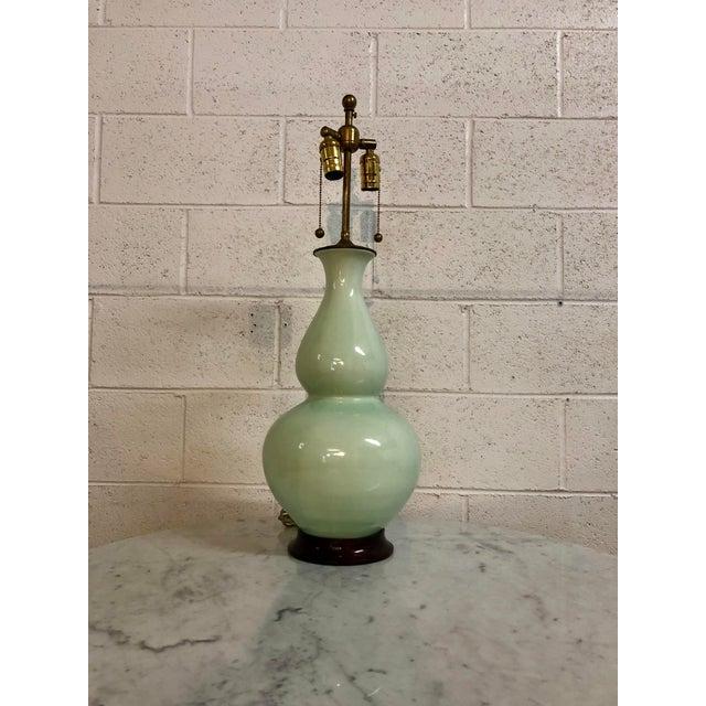 Signed 2002 mint green ceramic Christopher Spitzmiller lamp.
