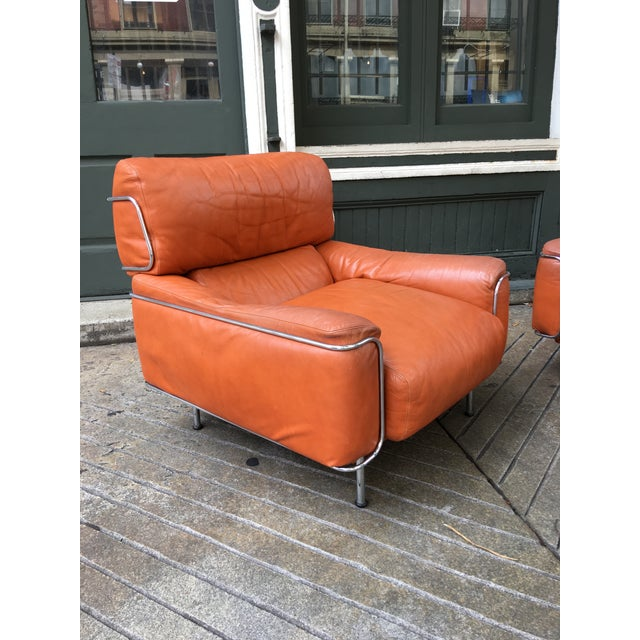 I love these Saporiti Leather Lounge Chairs! Unique Chrome Rod Framework holds the Leather Cushions in Place. Chairs date...