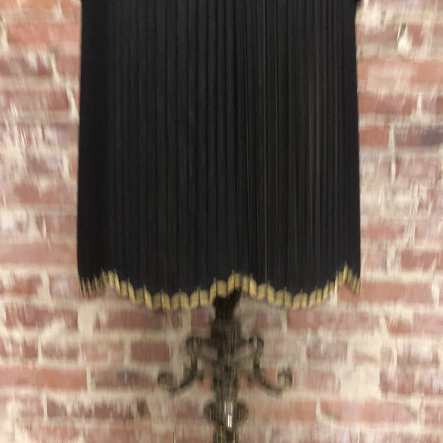 Mid-Century Hollywood Regency Large lamp with ornate aged brass and a central faceted smoky grey crystal. Large pleated...