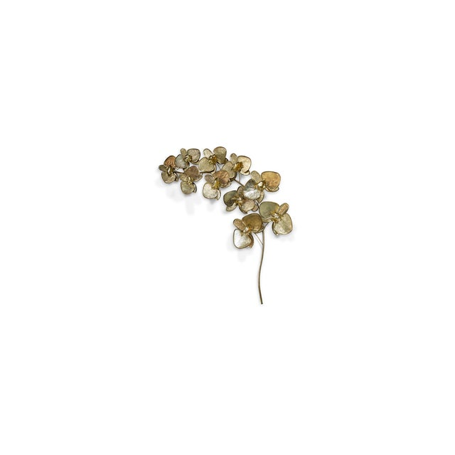 Representative of love, luxury, beauty and strength, delicate metal orchids gracefully curve across the artisanal Orchidea...
