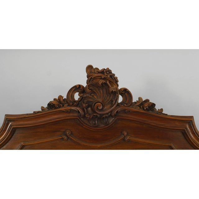French, Louis XV provincial style walnut full-size bed with shell carving. Headboard, footboard, rails, 19th-20th century.