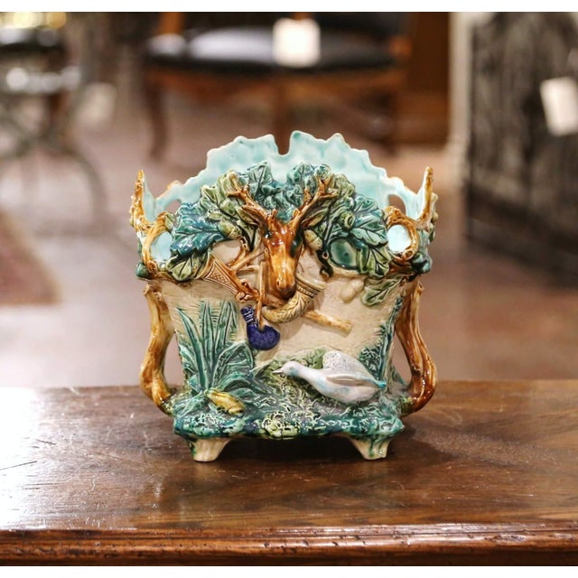 This colorful barbotine jardinière from L'Hermine a Orchies, France, was sculpted circa 1880. Almost square in shape, the...